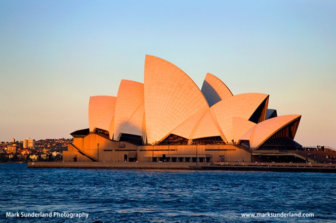 The last rays of the setting sun on the Opera House Sydney New South Wales Australia
