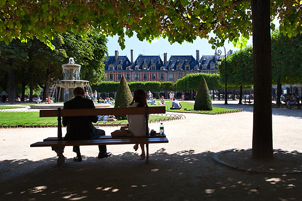 Sitting in the Shade at Place des Vosges in The Marais