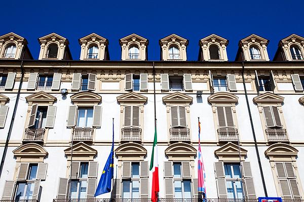 EU Italian and Piedmont Flags at the Palazzo della Regione in Piazza Castello