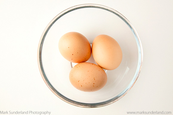 Three Brown Free Range Eggs in a Glass Bowl