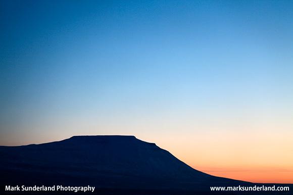 The Flat Topped Peak of Ingleborough at Sunset in Winter