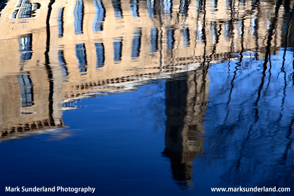 Reflection of New Mill in the River Aire Saltaire West Yorkshire England