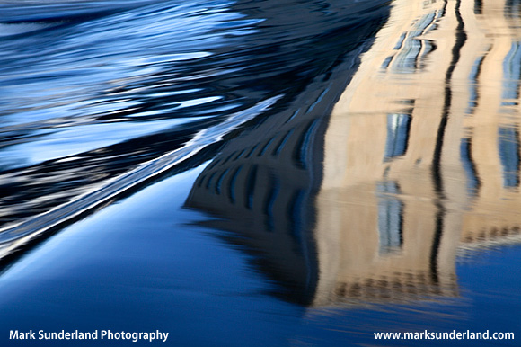 Abstract Reflection of New Mill in the River Aire Saltaire West Yorkshire England