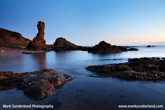 Twilight Glow on the Rock and Spindle on the Fife Coast path near St Andrews Fife Scotland
