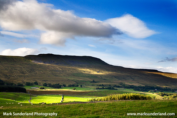 Sunlight on the face of Whernside one of the Yorkshire Three Peaks in the Yorkshire Dales England