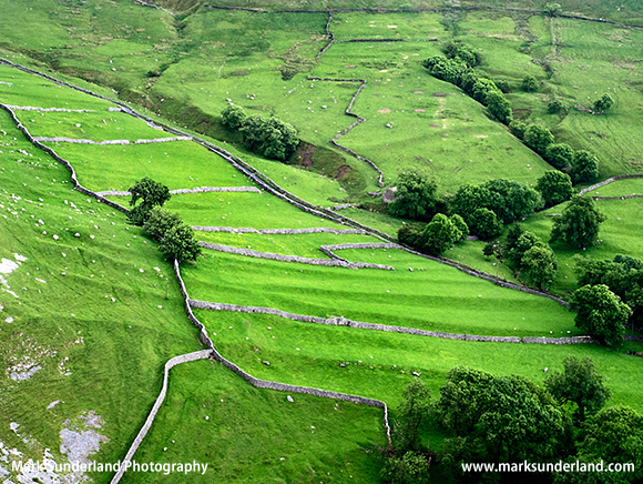 Meadows and Dry Stone Walls from above Gordale Scar near Malham Yorkshire Dales England