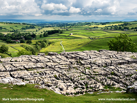 View over Malhamdale from Malham Cove in Summer Malham Yorkshire Dales England