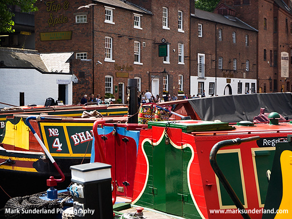Narrowboats on the Birmingham Canal and Canalside Pub at Gas Street Basin Birmingham West Midlands England