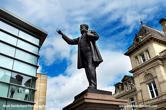 Statue of industrialist and MP William Edward Forster Flanked by Old and New Buildings in Forster Square Bradford West Yorkshire England