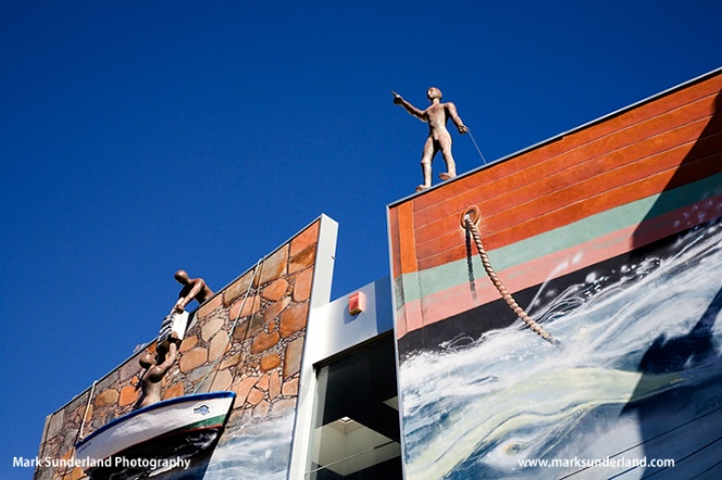Maritime Statues and Boat Mural on a Building in Puerto Santiago Tenerife Spain