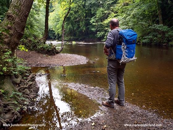 Walker with Osprey Talon 44 Backpack by the River Nidd Knaresborough North Yorkshire England