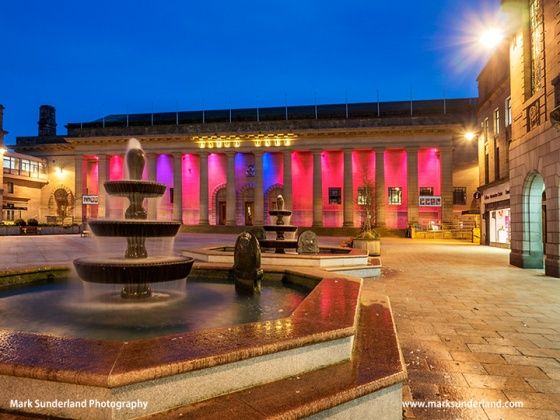 Fountains in City Square and Coloured Lights on Caird Hall at Dusk  Dundee Scotland