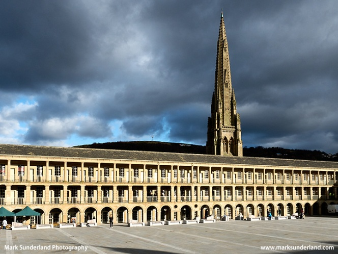 Stormy sky and sunlight on the Piece Hall in Halifax
