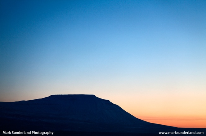 The Flat Topped Peak of Ingleborough at Sunset in Winter
