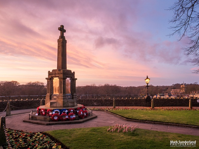 Pink sky at dusk over the War Memorial in the Castle Grounds at Knaresborough