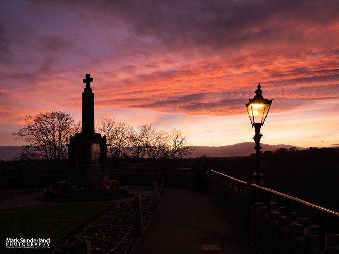 War Memorial in the Castle Grounds silhouetted against a sunset sky at Knaresborough