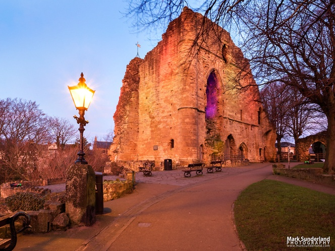 The Kings Tower at Knaresborough Castle bathed in pink light from a dusk sky