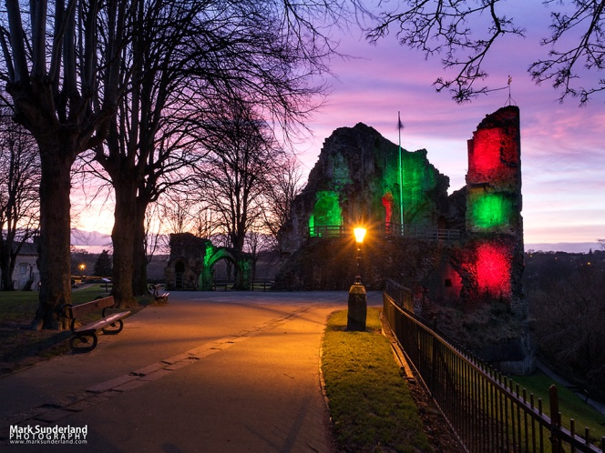 The Kings Tower at Knaresborough Castle floodlit with coloured lights at dusk