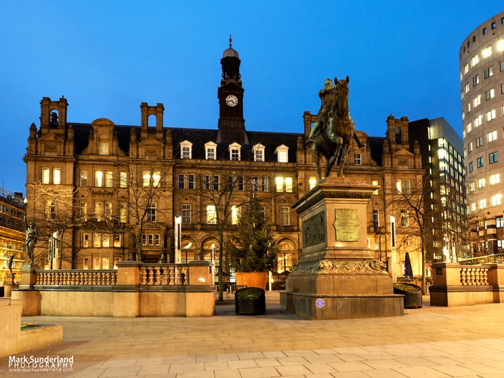 The Old Post Office Building and Black Pronce Statue at dusk in City Square Leeds