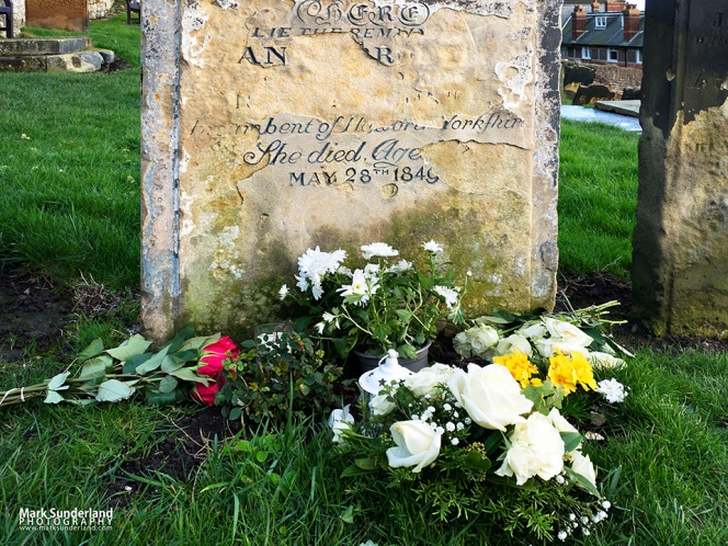 Anne Bronte grave with flowers laid for her bicentenary in January 2020
