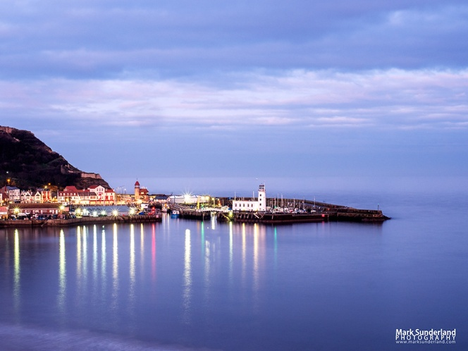 Reflections in South Bay of Scarborough Harbour at Dusk