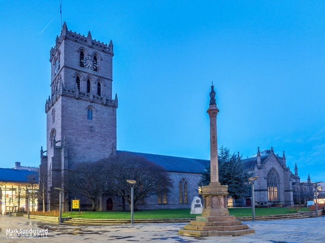 The Steeple Church and Mercat Cross at dusk Dundee Scotland