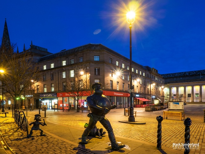 Desperate Dan and Minnie the Minx statues and City Square at dusk Dundee Scotland