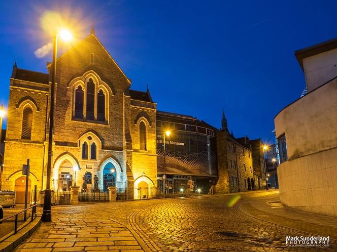 Aberdeen Maritime Museum floodlit at dusk